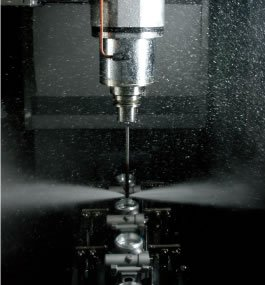 High-pressure water jet deburring